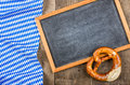 Blackboardand a pretzel with a bavarian diamond pattern empty Stock Images