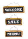 Blackboards set hanging in the wall - welcome, sale and menu chalkboard signs
