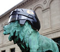 Blackhawks helmet in chicago may a helment was placed on one of the guardian lions at the entrance to the art institute as a show Royalty Free Stock Image