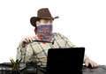 Blackmailer threatening with stolen usb flash drive in cowboy suit during skype conversation in robbed office Stock Photography
