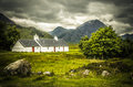 Blackrock Cottage with Meall a' Bhuird mountain in Rannoch Moor Scotland Royalty Free Stock Photo