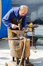 Blacksmith caminha portugal july a working on an anvil in the recreation of the middle ages in the streets of the city Royalty Free Stock Photo