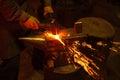 Blacksmith forfing hot iron Royalty Free Stock Photo