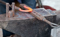 Blacksmith forging horseshoe anvil Royalty Free Stock Photo