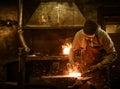 The Blacksmith Forging The Mol...