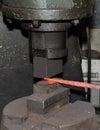 Blacksmith hammering hot iron Royalty Free Stock Photo