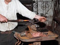 Blacksmith Hammering metal Royalty Free Stock Images