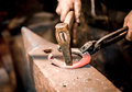 Blacksmith make a horseshoe Stock Photos