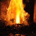 Blacksmith s fireplace burning flames in red hot smithery Royalty Free Stock Photo