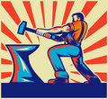 Blacksmith striking hammer and anvil Royalty Free Stock Photo
