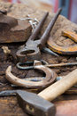 Blacksmith tools and horseshoes close-up Royalty Free Stock Photography