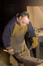 Blacksmith at work working on decorative handrail Stock Images