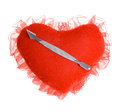 Blade for manicure on a plush heart beautiful with fringe which lie white background Stock Photography