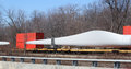 Blade for windmill shipped by train large rotor on a flatbed Royalty Free Stock Image