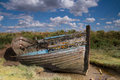 Blakeney wreck wooden boat on the flats at norfolk uk Royalty Free Stock Images