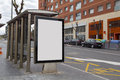 Blank advertisement in a bus shelter for free promo Royalty Free Stock Images