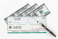 Blank Banking Check and Fountain Pen with Dollars Bills Royalty Free Stock Photo