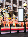 Blank billboard at christmas illuminated street. Royalty Free Stock Image
