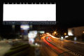 Blank billboard and light on highway road in night time. Royalty Free Stock Photo