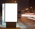 Blank billboard at night in the city Street Royalty Free Stock Photo