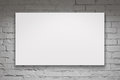 Blank billboard over white brick wall image of Stock Image