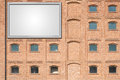 Blank billboard on red brick wall building Royalty Free Stock Image