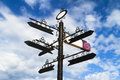 Blank black crossroad signs different directions on cloudy blue weather Stock Photography