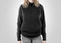 Blank black sweatshirt mock up isolated female wear dark hoodie mockup plain hoody design presentation clear gray loose overall Royalty Free Stock Photography