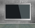 Blank black wide flat TV screen hanging on wall Royalty Free Stock Photo