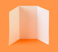 Blank brochure white on orange background Stock Images
