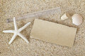 Blank brown paper outside a tube with cork lid removed on a sand Royalty Free Stock Photo