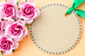 Blank brown paper tag and pink rose for your text on orange color background Stock Photos