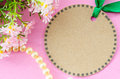 Blank brown tag circle shape and green ribbon with flower.