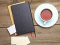 Blank business cards with pen and tea cup on wooden office table Royalty Free Stock Photo