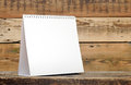 Blank calendar on wood table Royalty Free Stock Photography