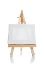 Blank canvas on easel Stock Photography