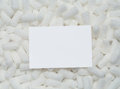 Blank card on packing peanuts Royalty Free Stock Photo