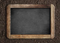 Blank chalkboard on soil background Royalty Free Stock Photo