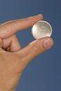 Blank coin in hand see my other works in portfolio Stock Image
