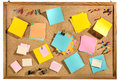 Blank colorful post it notes and office supplies on cork message board. Royalty Free Stock Photo
