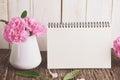 Blank Desk calendar with pink carnation flower Royalty Free Stock Photo