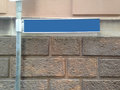 Blank direction blue sign on a pole the empty space is for free text caption Royalty Free Stock Images