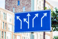Blank directional road signs over buildings Royalty Free Stock Photo