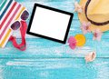 Blank empty tablet computer, summer accessories on Royalty Free Stock Photo