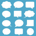 Blank empty white speech bubbles on blue backgroun background Royalty Free Stock Photography