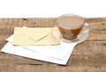 Blank envelopes and a glass coffee cup Royalty Free Stock Photography