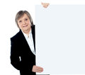 Blank executive female holding whiteboard Obraz Royalty Free