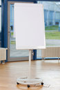 Blank flip chart on hardwood floor in boardroom Stock Photography