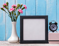Blank frame, pink flowers, alarm clock and souvenir Eiffel tower Royalty Free Stock Photo