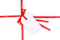 Blank gift tag with bow on red satin ribbon Royalty Free Stock Photo